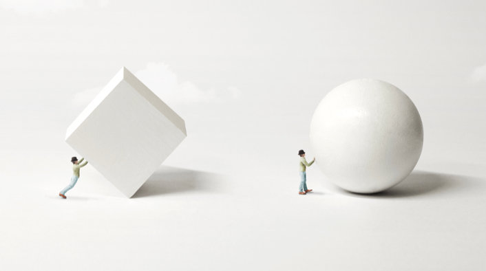 a person pushing a cube and a person pushing a sphere