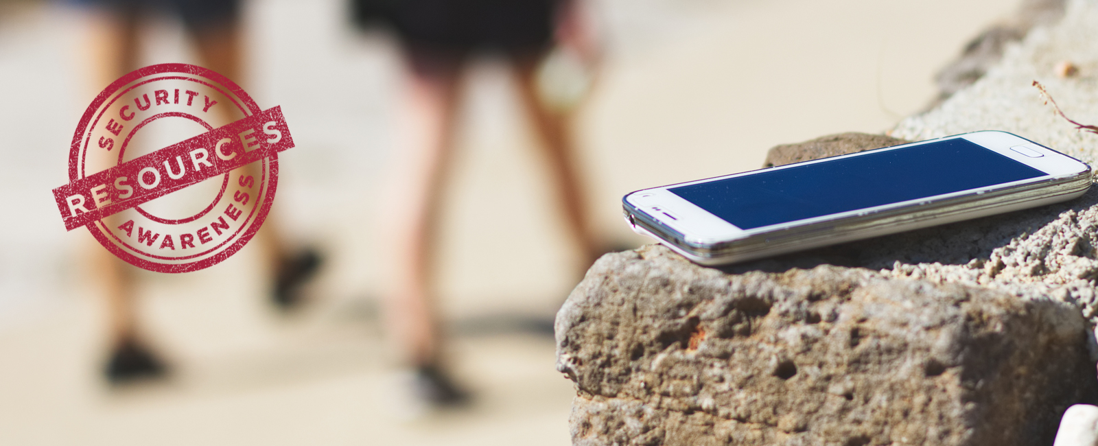 photo of mobile device sitting on stone wall