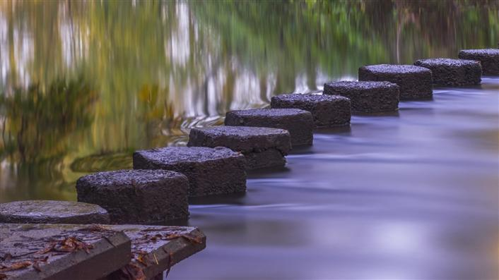 Stepping stones across water.