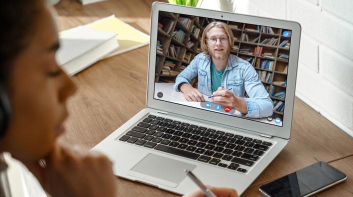 professor on laptop